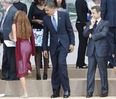 U.S. President Barack Obama and France's President Nicolas Sarkozy were caught admiring 16 year-old Brazilian junior G8 delegate Mayora Tavares' 'backside' when the two leaders were taking their places for a family photo-op with junior G8 delegates at the G8 summit in L'Aquila, Italy.